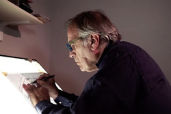 Giorgio Piola works on a drawing