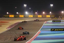 Sebastian Vettel, Ferrari SF71H, Valtteri Bottas, Mercedes AMG F1 W09, Kimi Raikkonen, Ferrari SF71H, and Daniel Ricciardo, Red Bull Racing RB14 Tag Heuer, and the rest of the field