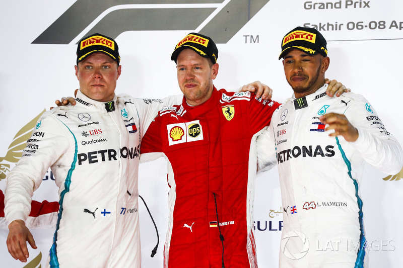 Valtteri Bottas, Mercedes AMG F1, 2nd position, Sebastian Vettel, Ferrari, 1st position, and Lewis Hamilton, Mercedes AMG F1, 3rd position, on the podium