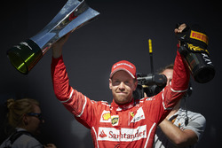 Race winner Sebastian Vettel, Ferrari and Champagne bottle