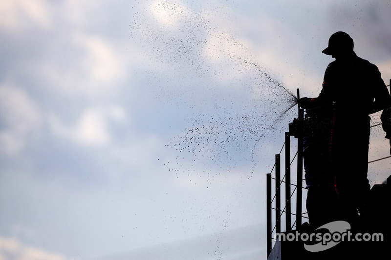 Max Verstappen, Red Bull Racing, sprays the champagne on the podium after finishing second