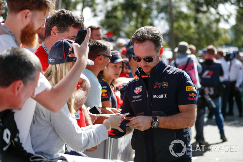 Christian Horner, Team Principal, Red Bull Racing, signs autographs for fans