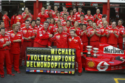 Michael Schumacher, Ferrari F2004 celebrates with the Ferrari team after winning his 7th world championship with Jean Todt and Ross Brawn