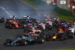 Valtteri Bottas, Mercedes AMG F1 W08, leads Max Verstappen, Red Bull Racing RB13, Kimi Raikkonen, Ferrari SF70H, Felipe Massa, Williams FW40, and the remainder of the field at the start