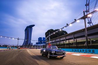 Kimi Raikkonen, Ferrari, rides in a Lancia Flaminia cabriolet on the drivers' parade
