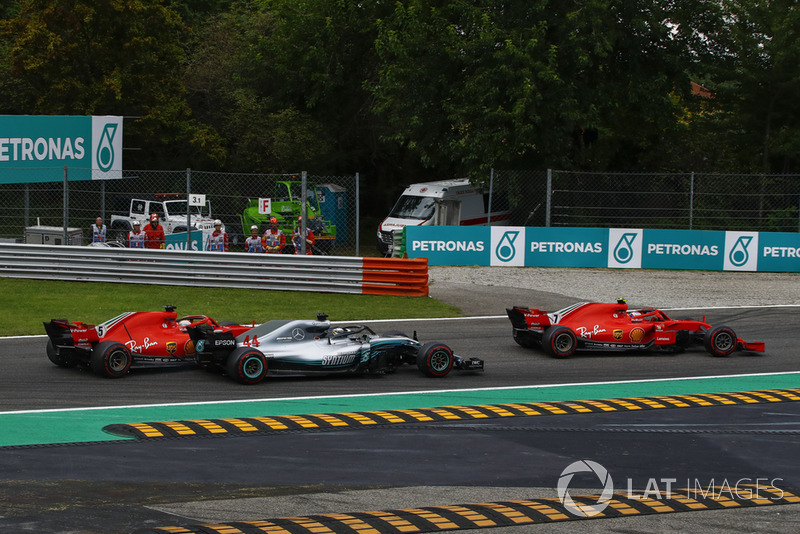 Sebastian Vettel, Ferrari SF71H making contact with Lewis Hamilton, Mercedes AMG F1 W09 and Kimi Raikkonen, Ferrari SF71H leads the race