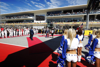 Grid Kids, drivers, dignitaries and the Dallas Cowboys Cheerleaders on the grid