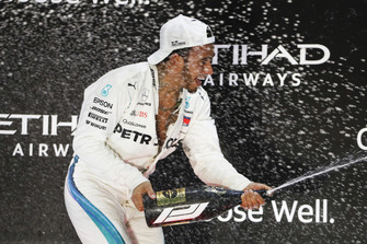 Lewis Hamilton, Mercedes AMG F1, 1st position, sprays Rose Water on the podium