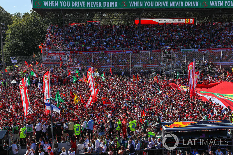 Ferrari Fans and flags at the podium celebrations on the podium