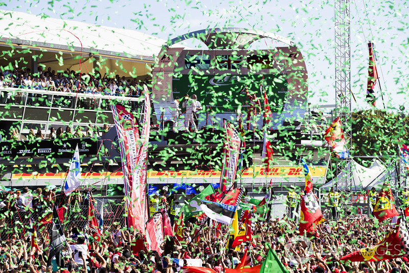 Confetti falls as Race winner Lewis Hamilton, Mercedes AMG F1, Second place Third place Valtteri Bottas, Mercedes AMG F1 Sebastian Vettel, Ferrari, celebrate on the podium