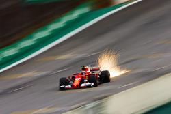 Sparks fly from the car of Kimi Raikkonen, Ferrari SF70H