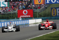 Nick Heidfeld, BMW Sauber F1.06 battles with Michael Schumacher, Ferrari 248 F1