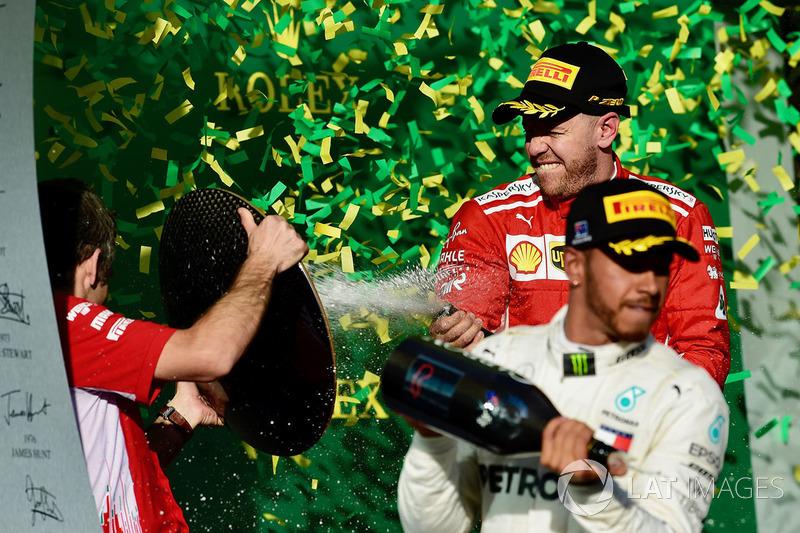 Lewis Hamilton, Mercedes-AMG F1 and Sebastian Vettel, Ferrari celebrate on the podium with the champagne