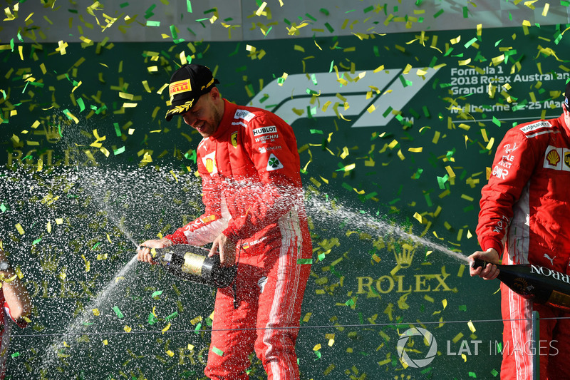 Sebastian Vettel, Ferrari celebrates on the podium with the champagne