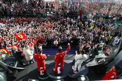 Race winner Sebastian Vettel, Ferrari, second place Lewis Hamilton, Mercedes AMG F1, third place, Kimi Raikkonen, Ferrari, celebrate on the podium