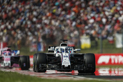 Lance Stroll, Williams FW41, leads Sergio Perez, Force India VJM11