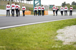 Marcus Ericsson, Sauber, walks the circuit alongside colleagues, including team-mate Charles Leclerc, Sauber