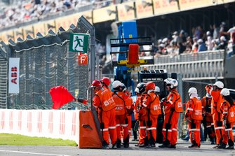 Marshals wave the red flag to stop the race