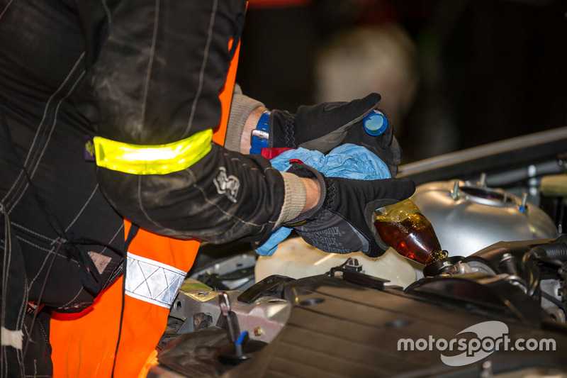 Mechanic adding oil