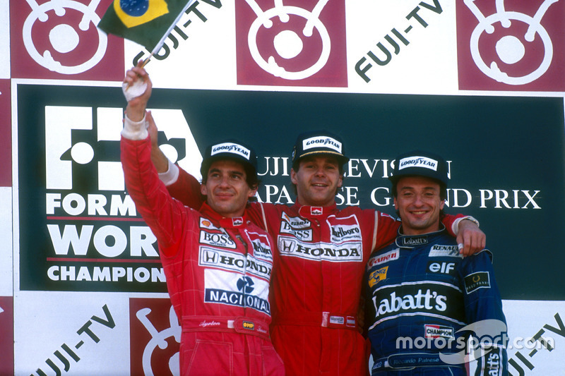 Podium: Race winner Gerhard Berger, McLaren, second place and Worldchampion Ayrton Senna, McLaren; third place Riccardo Patrese, Williams
