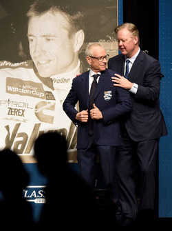 NASCAR Hall of Fame inductee Mark Martin receives his Hall of Fame jacket from NASCAR Chief Executive Officer and Chairman Brian France