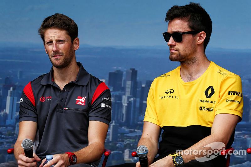 Romain Grosjean, Haas F1 Team; Jolyon Palmer, Renault Sport F1 Team