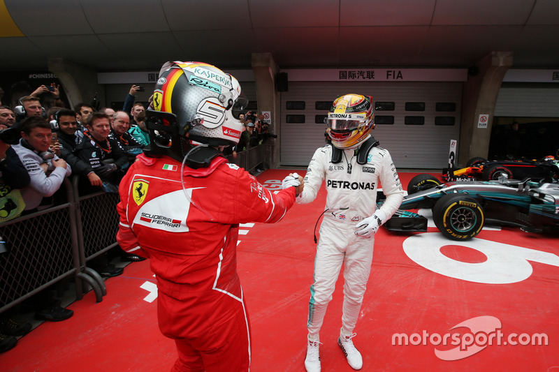 Sebastian Vettel, Ferrari congratulates Lewis Hamilton, Mercedes AMG, in parc ferme after the race