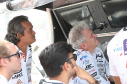 Team watching the race on pit wall