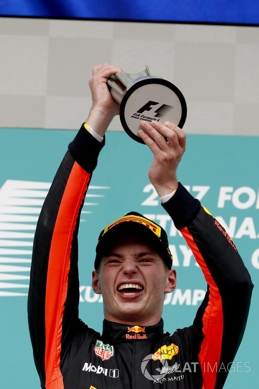 Max Verstappen, Red Bull Racing, race winner, lifts his trophy on the podium