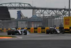 Lewis Hamilton, Mercedes-Benz F1 W08  and Romain Grosjean, Haas F1 Team VF-17