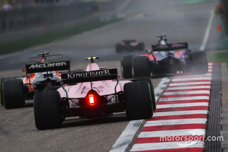 Fernando Alonso, McLaren MCL32, leads Esteban Ocon, Force India VJM10