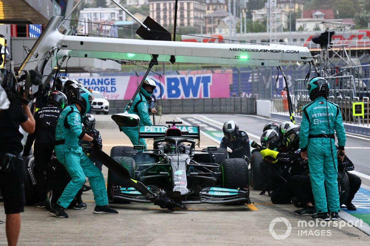 Lewis Hamilton, Mercedes W12, makes a pit stop