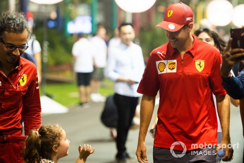 Sebastian Vettel, Ferrari, speaks to a young fan