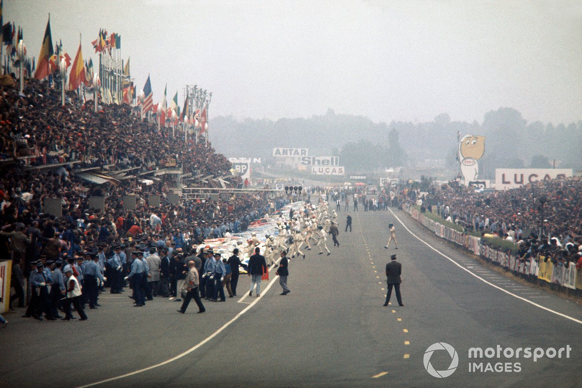 All the drivers make the traditional running start, except for Jacky Ickx who walks across the track in protest