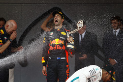 Race winner Daniel Ricciardo, Red Bull Racing, is sprayed by champagne on the podium with Adrian Newey, Chief Technical Officer, Red Bull Racing, and Lewis Hamilton, Mercedes AMG F1