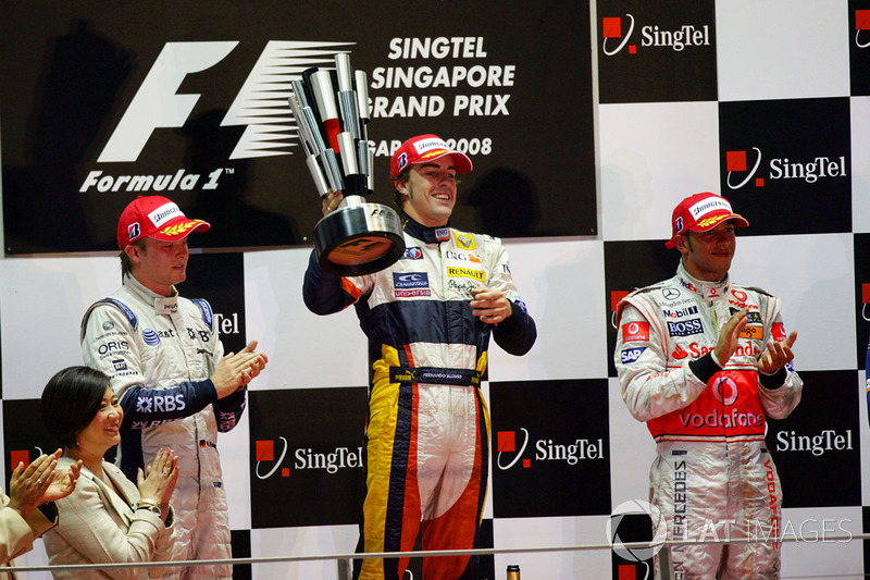 Nico Rosberg, Williams FW30 Toyota, 2nd position, Fernando Alonso, Renault R28, 1st position, and Lewis Hamilton, McLaren MP4-23 Mercedes, 3rd position