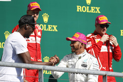 Race winner Lewis Hamilton, Mercedes AMG F1, second place Sebastian Vettel, Ferrari, third place Kimi Raikkonen, Ferrari, with Usain Bolt