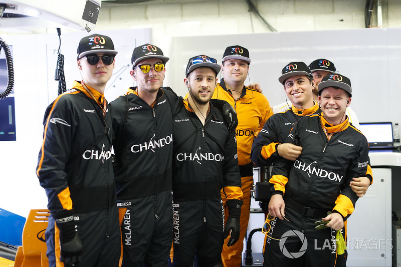 McLaren pit crew with hats celebrating the 300th start for their driver Fernando Alonso, McLaren