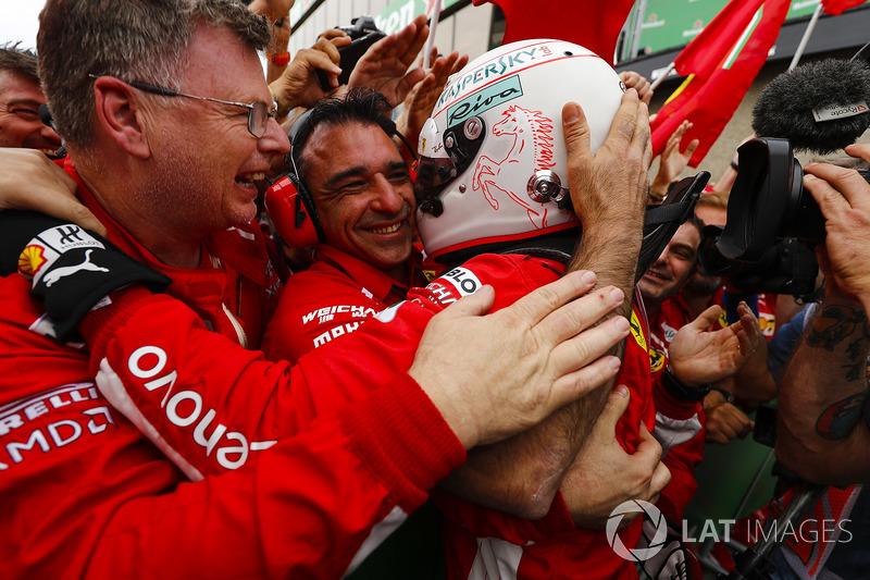 Sebastian Vettel, Ferrari, celebrates victory with his team in parc ferme