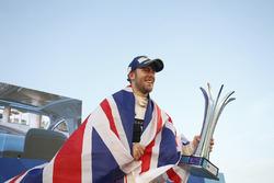 Race winner Sam Bird, DS Virgin Racing, celebrates with his trophy on the podium