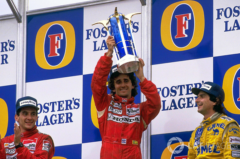Podium: race winner Alain Prost, McLaren, second place Ayrton Senna, McLaren, third place Nelson Piquet, Lotus