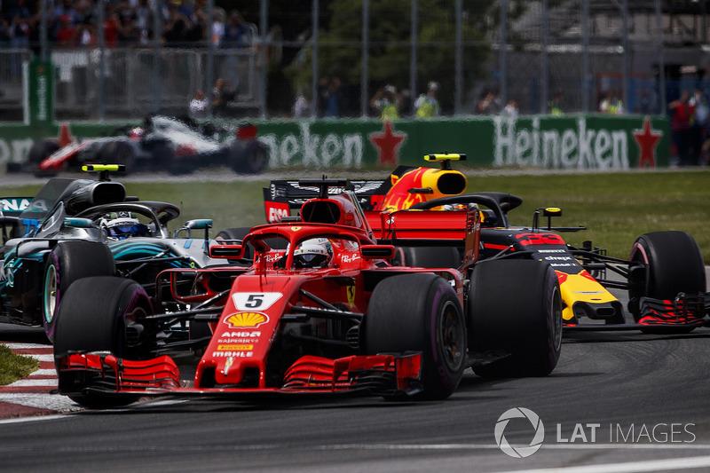 Sebastian Vettel, Ferrari SF71H, leads Max Verstappen, Red Bull Racing RB14, and Valtteri Bottas, Me