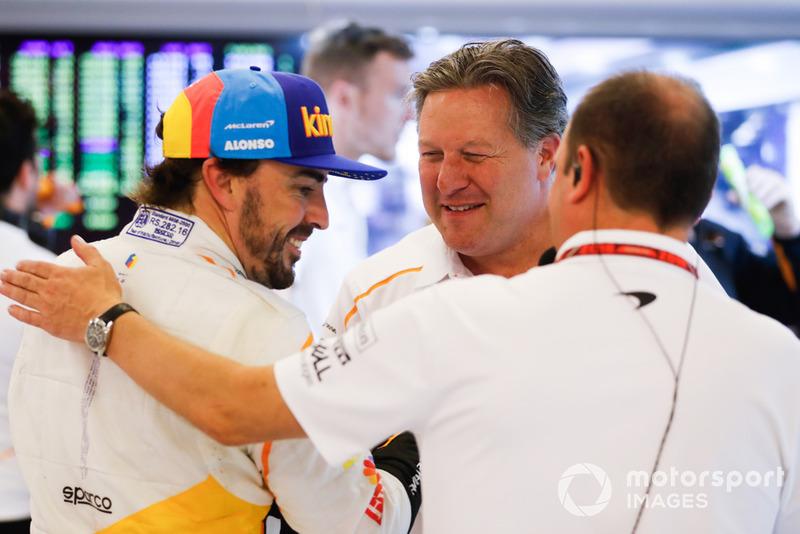 Fernando Alonso, McLaren, and Zak Brown, Executive Director, McLaren Racing, in the garage
