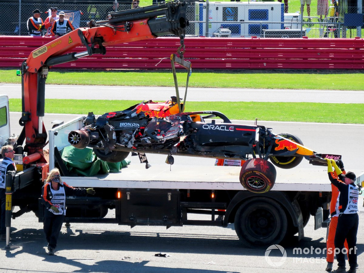 Max Verstappen, Red Bull Racing RB16B, is taken to the pits after the accident.