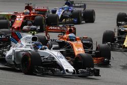 Lance Stroll, Williams FW40, Fernando Alonso, McLaren MCL32, Sebastian Vettel, Ferrari SF70H, Marcus Ericsson, Sauber C36, at the start