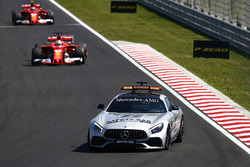 The Safety Car leads Sebastian Vettel, Ferrari SF70H, Kimi Raikkonen, Ferrari SF70H