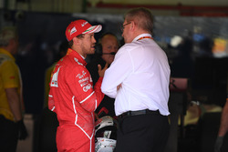 Sebastian Vettel, Ferrari and Ross Brawn, Formula One Managing Director of Motorsports in parc ferme