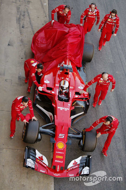Sebastian Vettel, Ferrari, returns to the pits with a car problem