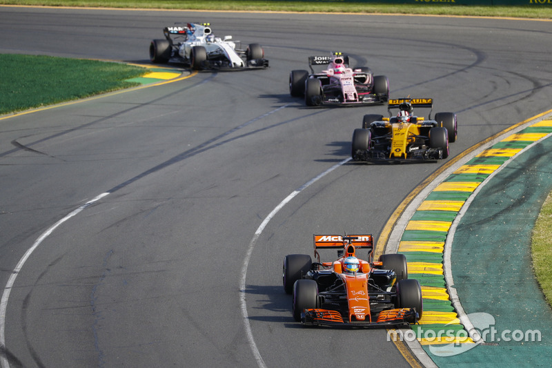 Fernando Alonso, McLaren MCL32, leads Nico Hulkenberg, Renault Sport F1 Team RS17, and Esteban Ocon, Force India VJM10