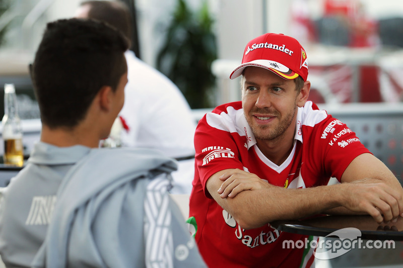 Pascal Wehrlein, Manor Racing con Sebastian Vettel, Ferrari
